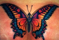 Yellow and blue butterfly tattoo