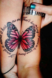 Two halves of a butterfly tattoo