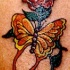Yellow butterfly and red rose tattoo